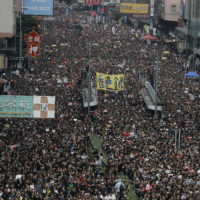 Protesters march through the streets in Hong Kong as they continue to protest an extradition bill, Sunday, June 16. (Vincent Yu/AP)