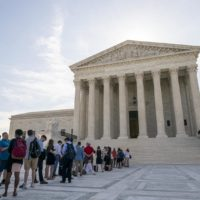 Visitors line up at the Supreme Court in Washington as the justices prepare to hand down decisions, Monday, June 17, 2019. (J. Scott Applewhite/AP)