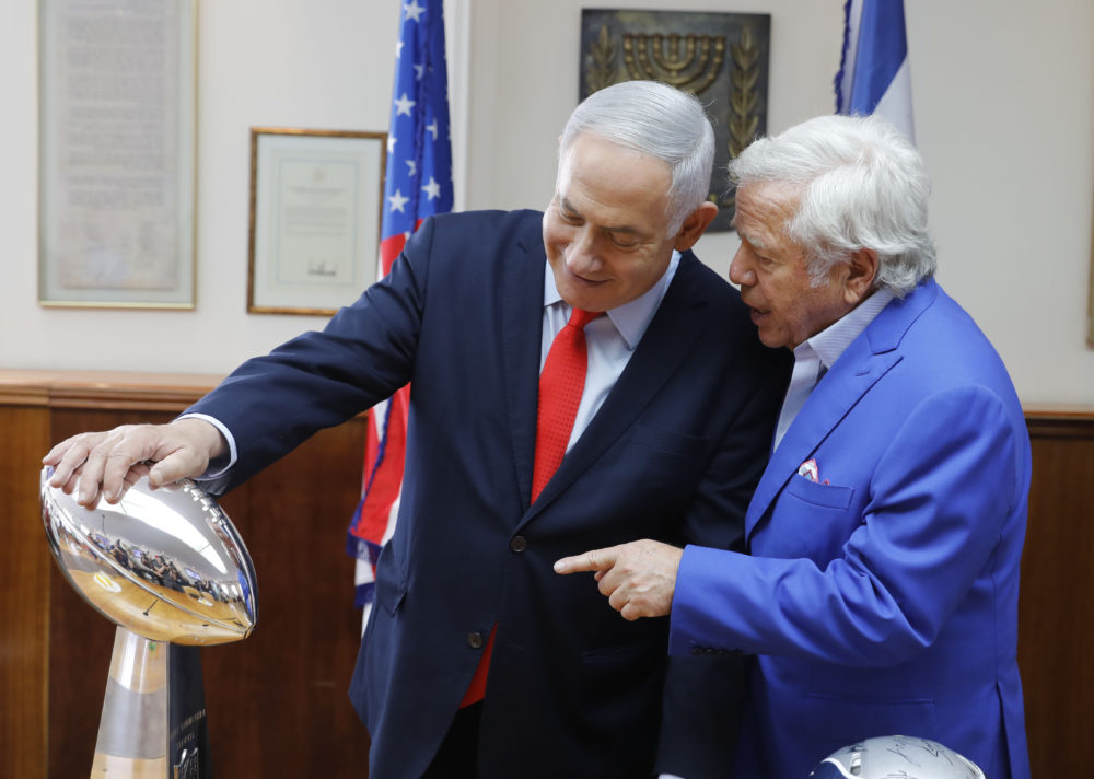 Israeli Prime Minister Benjamin Netanyahu holds the NFL Super Bowl trophy during a meeting with New England Patriots owner Robert Kraft in Jerusalem Thursday. Israel will honor Kraft with the 2019 Genesis Prize for his philanthropy and commitment to combating anti-Semitism. (Sebastian Scheiner/AP)