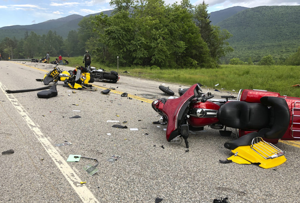 This photo provided by Miranda Thompson shows the scene where several motorcycles and a pickup truck collided on a rural, two-lane highway in Randolph, N.H. (Miranda Thompson via AP)