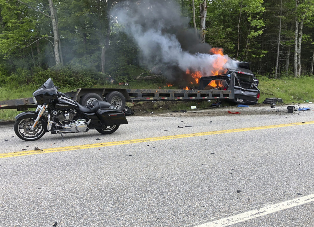 Several motorcycles and a pickup truck collided on a rural, two-lane highway Friday, June 21, 2019 in Randolph, N.H. (Miranda Thompson via AP)