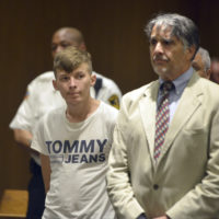 Volodymyr Zhukovskyy, 23, of West Springfield, stands with his attorney Donald Frank during his arraignment in Springfield District Court on Monday. Zhukovskyy was charged Monday with seven counts of negligent homicide. (Don Treeger/The Republican via AP, Pool)