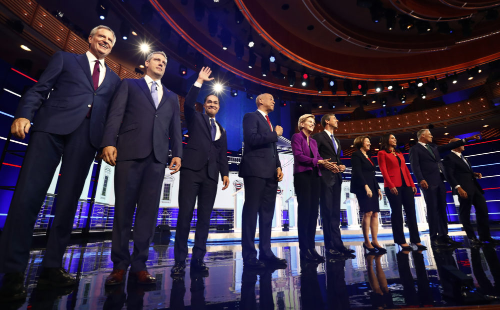 Democratic presidential candidates pose for a photo before the start of the first Democratic primary debate hosted by NBC News on Wednesday, June 26, 2019, in Miami. (Brynn Anderson/AP)