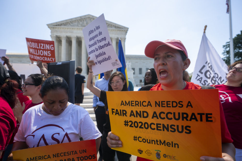 Demonstrators gather at the Supreme Court as the justices Thursday. (J. Scott Applewhite/AP)