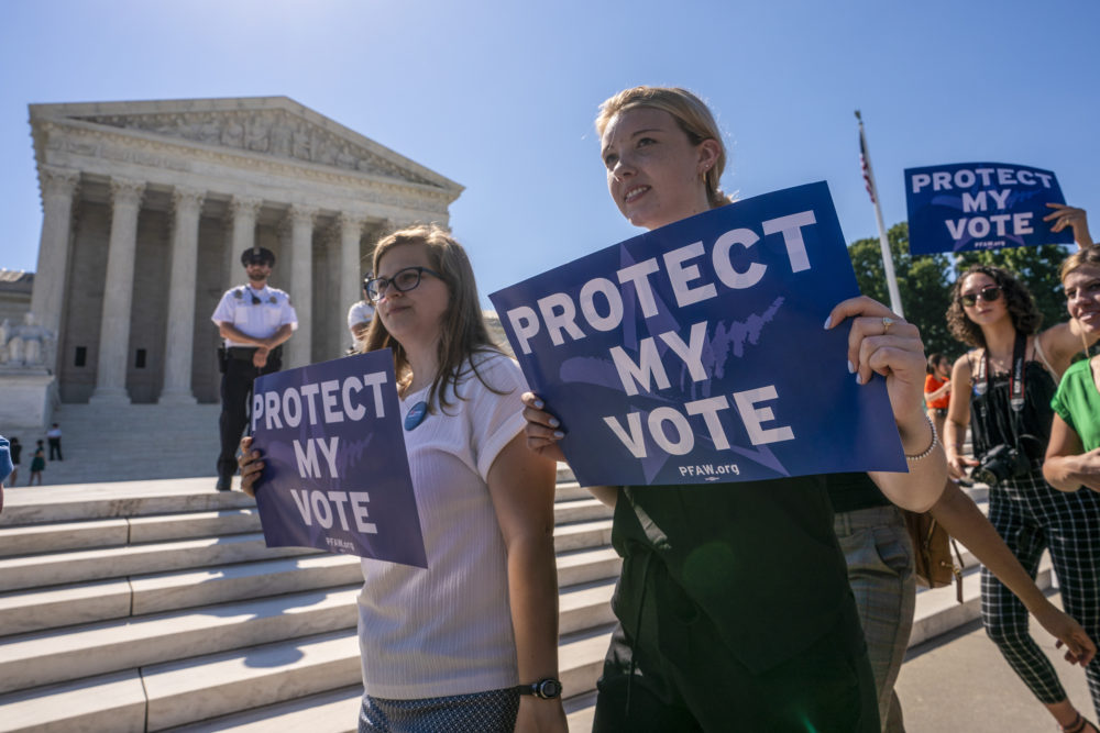 Demonstrators gather at the Supreme Court as the justices finish the term with key decisions on gerrymandering and a census case on Capitol Hill in Washington, Thursday, June 27, 2019. (J. Scott Applewhite/AP)