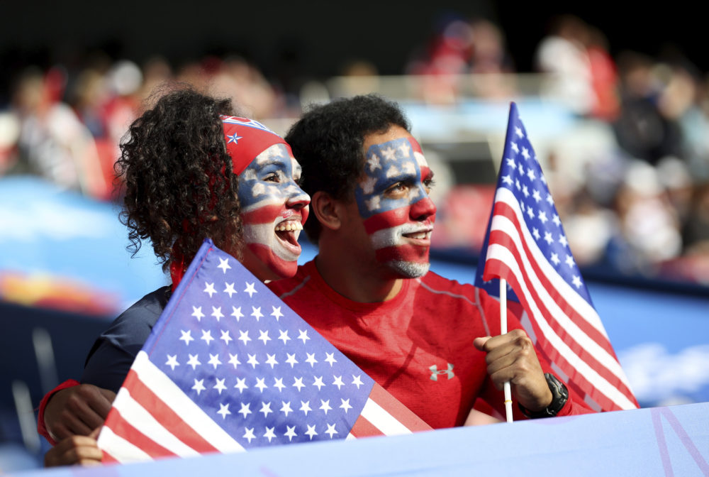 Fans for the U.S. hold U.S. flags and have painted faces prior to the Women's World Cup quarterfinal soccer match between France and the United States at the Parc des Princes, in Paris, Friday, June 28, 2019. (AP Photo/Francisco Seco)