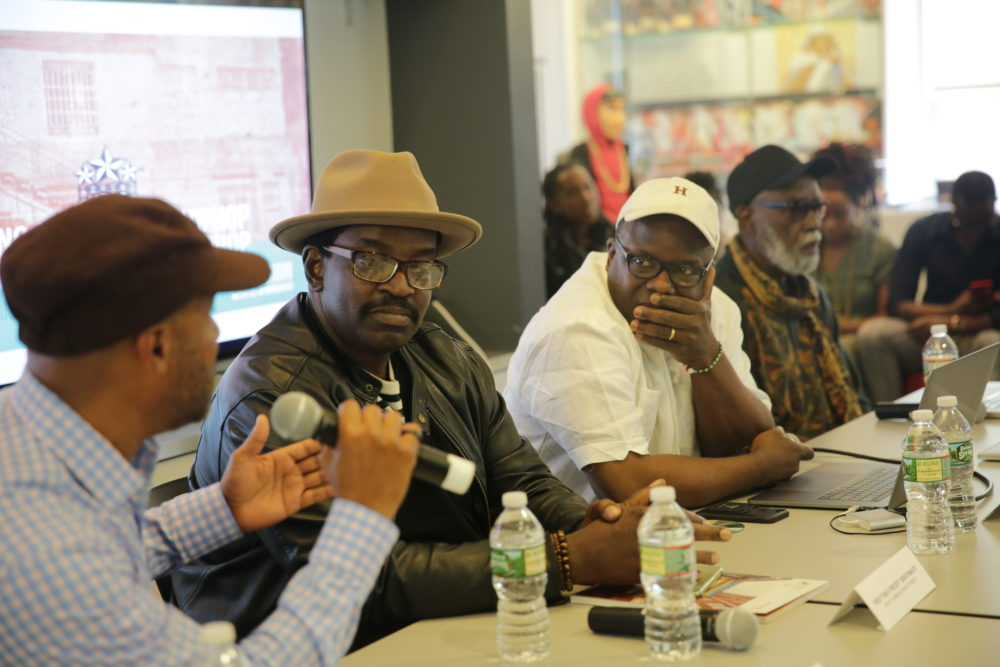 "Marc Perry, Fred ""Fab 5 Freddy"" Brathwaite, Pablo D. Herrera Veitia and Ben Caldwell at an event titled ""Celebrating Afro-Cuba Hip-Hop."" (Courtesy Harvard)"