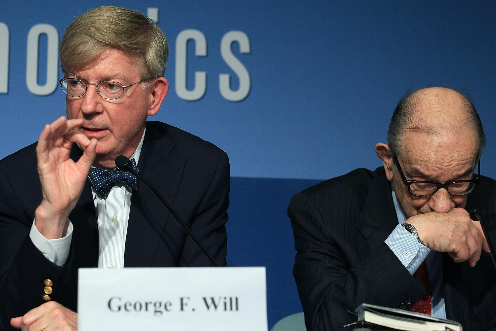 Former Federal Reserve Chairman Alan Greenspan (right) and columnist George Will participate in a discussion about the late U.S. Senator Daniel Patrick Moynihan, at the Peterson Institute for International Economics on Oct. 27, 2010. (Mark Wilson/Getty Images)