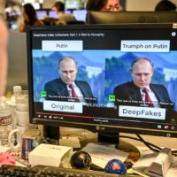 A journalist views a video on Jan. 25, 2019, manipulated with artificial intelligence to potentially deceive viewers. (Alexandra Robinson/AFP/Getty Images)
