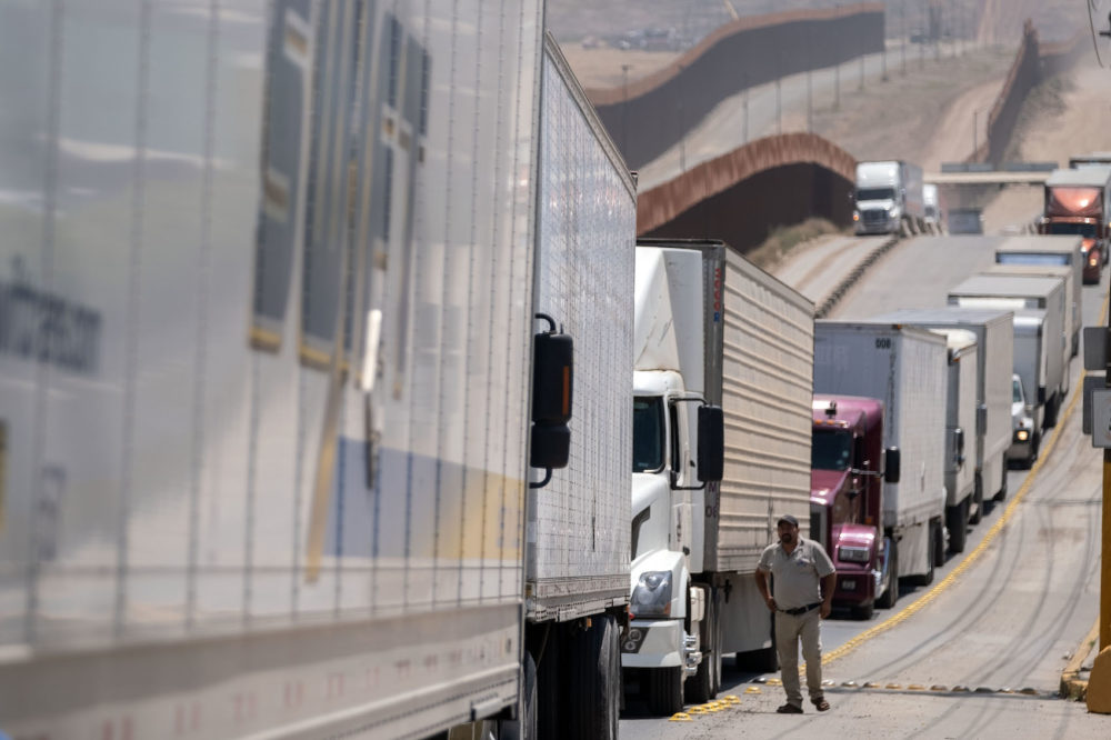 Cargo truck drivers line up to cross to the United States at Otay commercial crossing port in Tijuana, Baja California state, on June 6, 2019, Mexico. (Guillermo Arias/AFP/Getty Images)