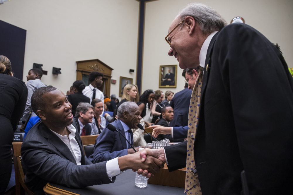 Writer Ta-Nehisi Coates shakes hands with House Subcommittee Chairman Steve Cohen, D-Tenn., during a hearing on slavery reparations held by the House Judiciary Subcommittee on the Constitution, Civil Rights and Civil Liberties on June 19, 2019 in Washington, D.C. (Zach Gibson/Getty Images)