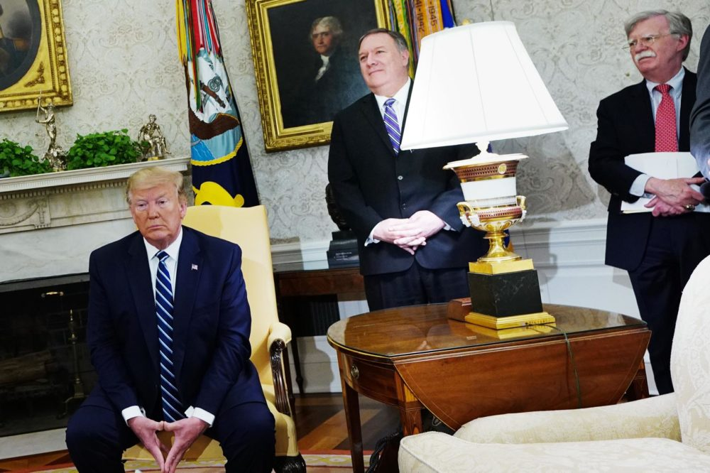 (From left) President Trump, Secretary of State Mike Pompeo, and National Security Adviser John Bolton are seen during a bilateral meeting with Canada's Prime Minister Justin Trudeau in the Oval Office of the White House in Washington, D.C. on June 20, 2019. (Mandel Ngan/AFP/Getty Images)
