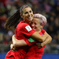 Alex Morgan celebrates with teammate Megan Rapinoe after scoring her fifth goal in Team USA's blowout win against Thailand. (Robert Cianflone/Getty Images)