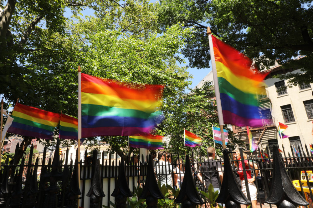 Rainbow pride flags fly outside the Stonewall Inn as crowds begin to gather to celebrate Pride Month in New York City. (Spencer Platt/Getty Images)