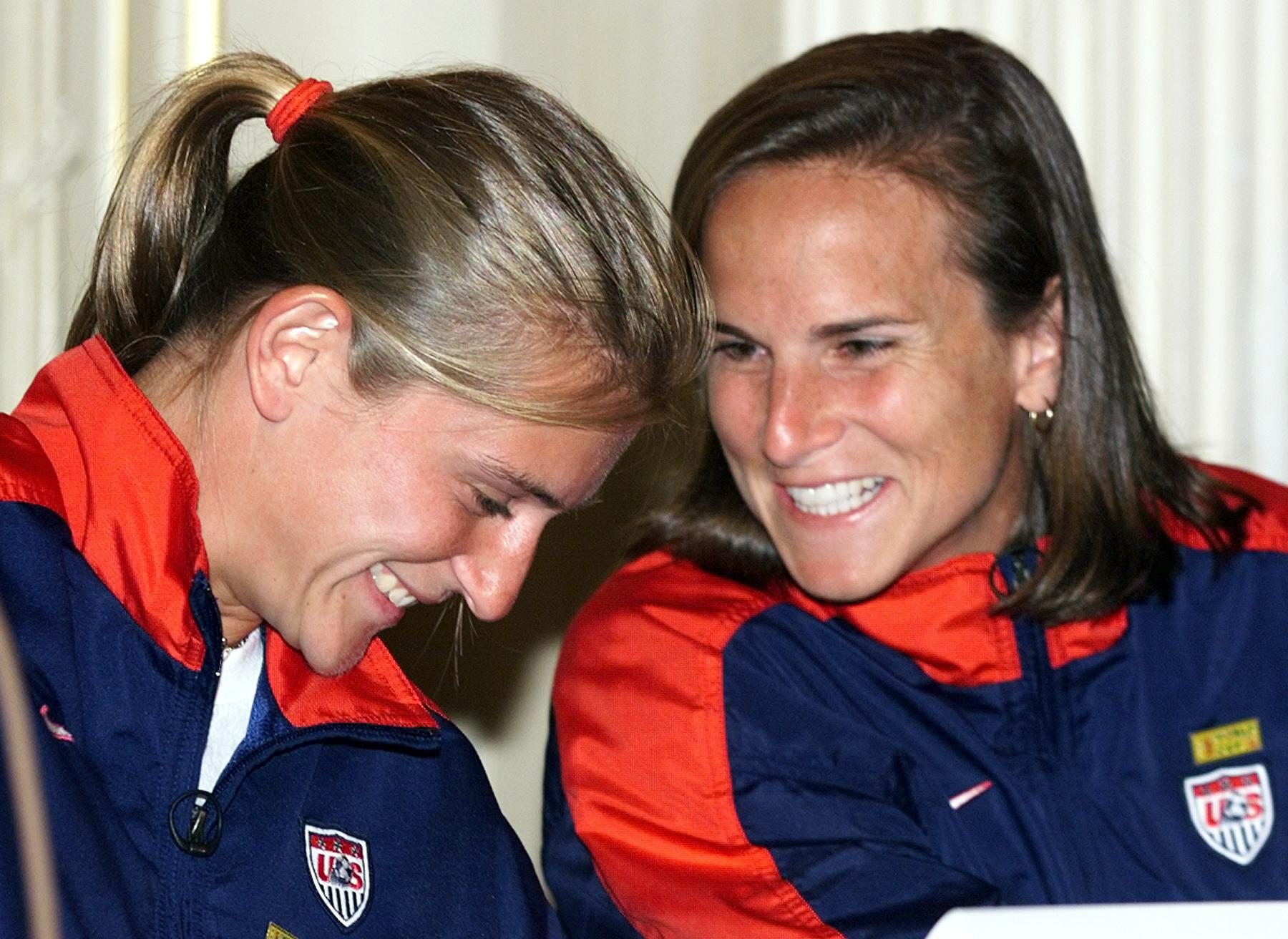 Team USA members Tiffeny Milbrett and Carla Overbeck. (Timothy Clary/AFP/Getty Images)