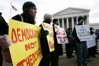 Activists hold posters during a rally in front of the U.S. Supreme Court to support separation of church and state, March 2, 2005, in Washington, D.C. (Alex Wong/Getty Images)