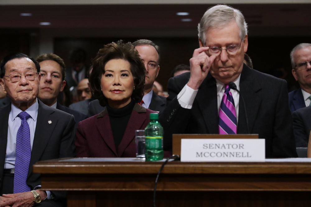 Elaine Chao (center) listens to her husband Senate Majority Leader Mitch McConnell, R-Ky., during her confirmation hearing to be the next U.S. secretary of transportation, Jan. 11, 2017. (Chip Somodevilla/Getty Images)