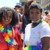 Britany Wade, left, with sister Brianna Strange celebrate at Boston's 49th Pride Parade celebration at Copley Square. (Quincy Walters/WBUR)