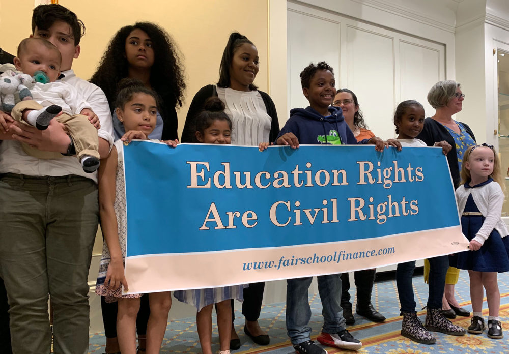 Parents and students from seven Massachusetts communities say they filed the lawsuit because legislative efforts to get more funding for their schools are taking too long and don't go far enough. (Carrie Jung/WBUR)