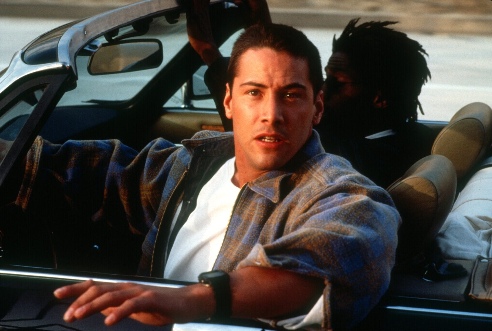 "Keanu Reeves, left, as Officer Jack Traven with Glenn Plummer as Maurice (aka Jaguar Owner) in ""Speed"" (1994). (Courtesy Twentieth Century Fox/Photofest)"