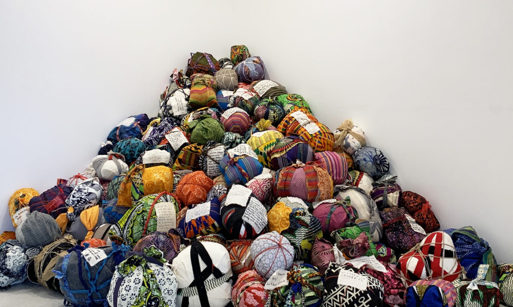 """A close-up view of the bundles in Yu-Wen Wu's exhibition """"Leavings/Belongings"""" at the Pao Arts Center. (Courtesy)"""
