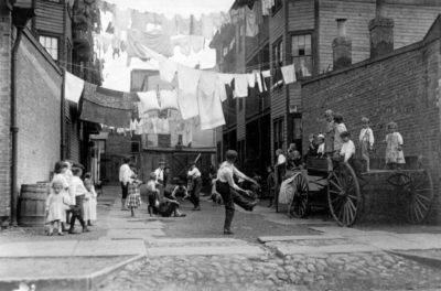 """""""Playground in a Tenement Alley,"""" Lewis Wickes Hine, circa 1909. (Courtesy Art Institute of Chicago)"""