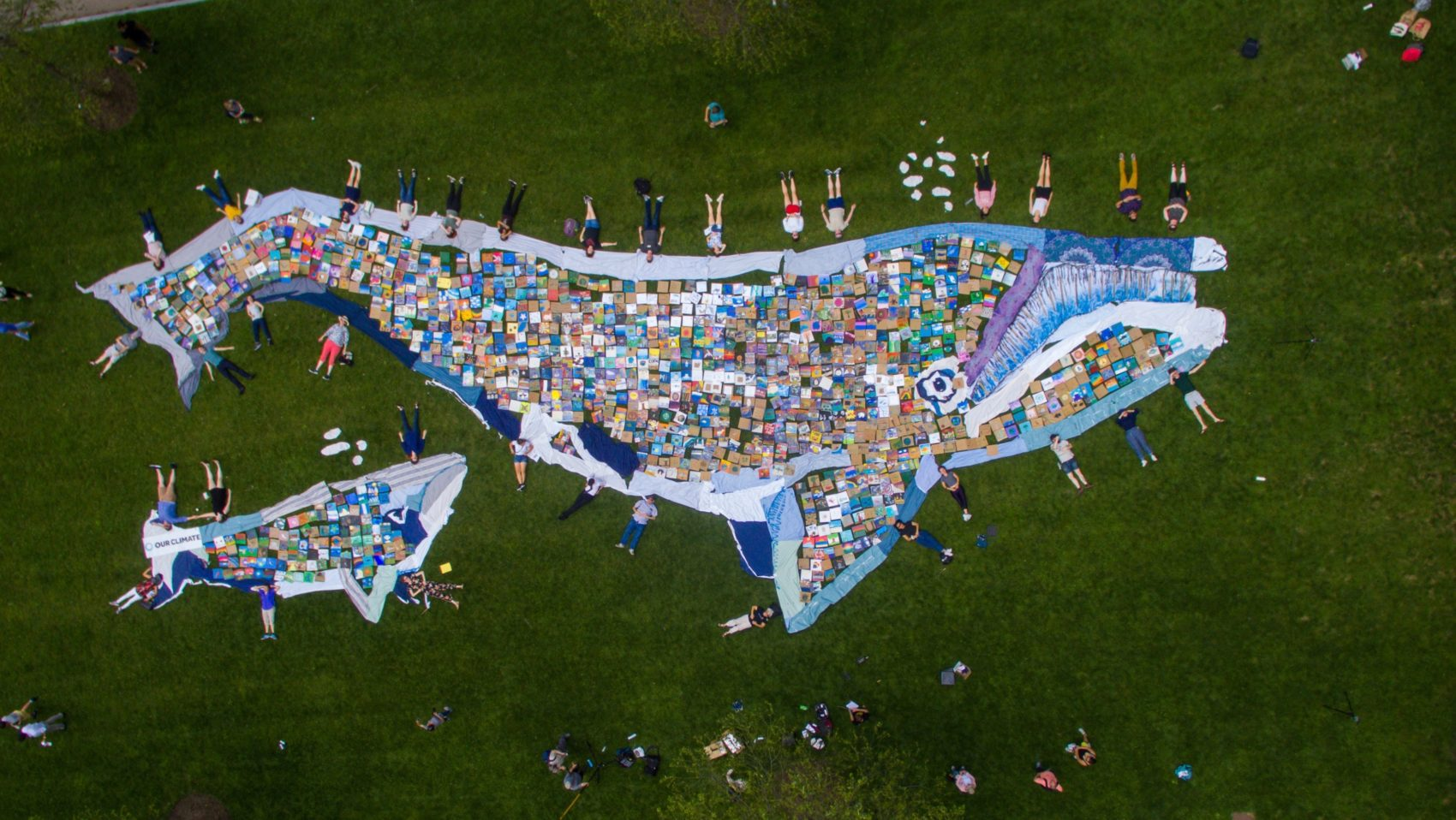 Young climate activists constructed a 100-foot mosaic out of 1,200 individually painted tiles. (Courtesy of Lucian Sharpe/Our Climate)