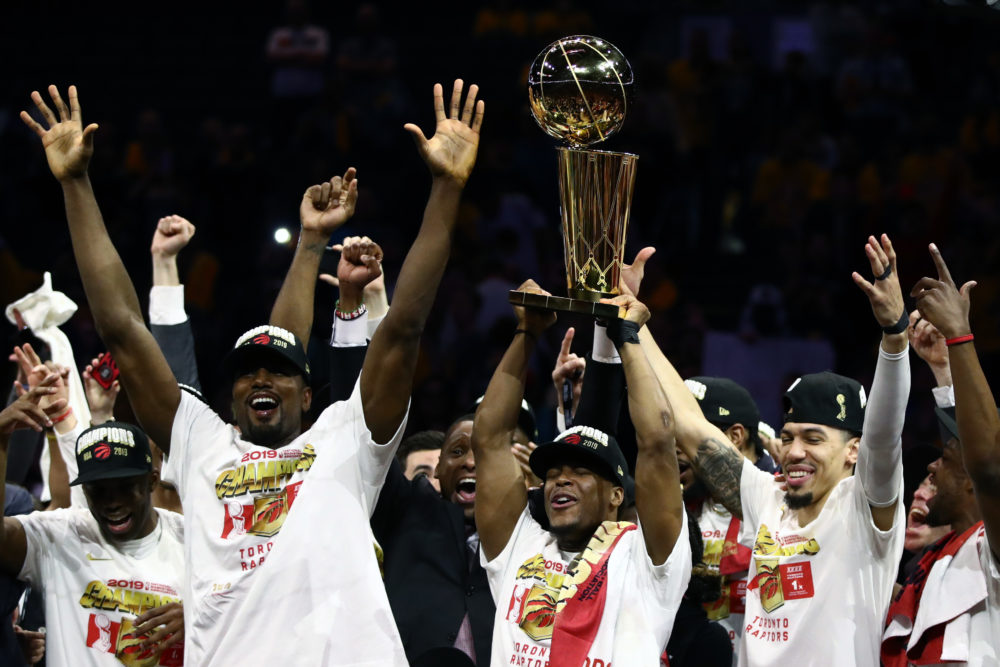 The Toronto Raptors celebrate with the Larry O'Brien Trophy. (Ezra Shaw/Getty Images)