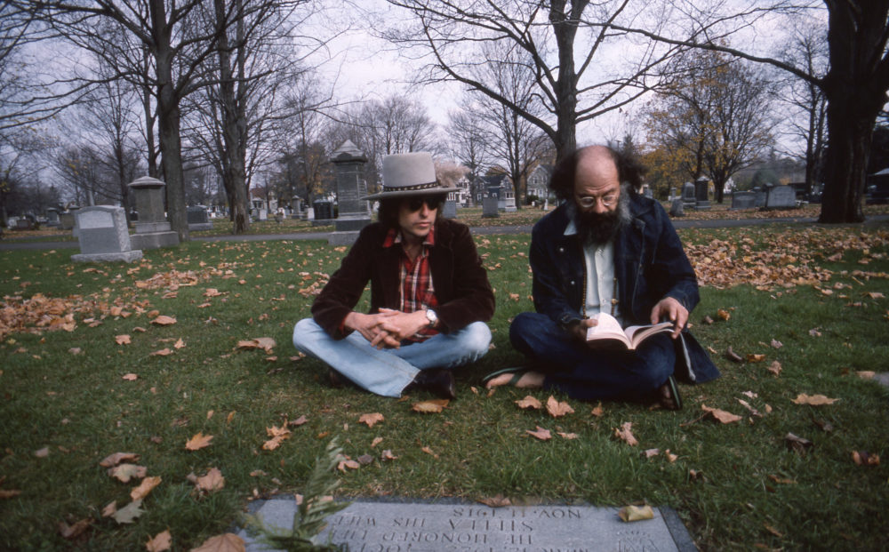 "Bob Dylan and Allen Ginsberg at the grave of Jack Kerouac in ""Rolling Thunder Review: A Bob Dylan Story by Martin Scorsese."" (Courtesy Netflix)"