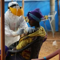 Partners In Health recruit Dr. Dana Clutter tends to a patient in the triage area of the Maforki Ebola treatment unit in Sierra Leone on Jan. 15, 2015. (Photo by Rebecca E. Rollins/Partners In Health)