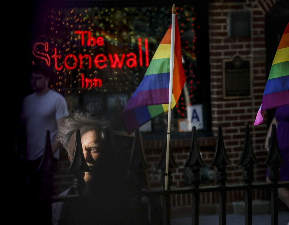 In this Monday, June 3, 2019, photo, gay rights activist Jim Fouratt stands across the street from The Stonewall Inn bar in New York. Fouratt witnessed an arrest at the bar on the night of June 27, 1969, that foreshadowed a series of violent confrontations between the New York Police Department and the bar's gay patrons, sparking a movement for gay rights. (Bebeto Matthews/AP)