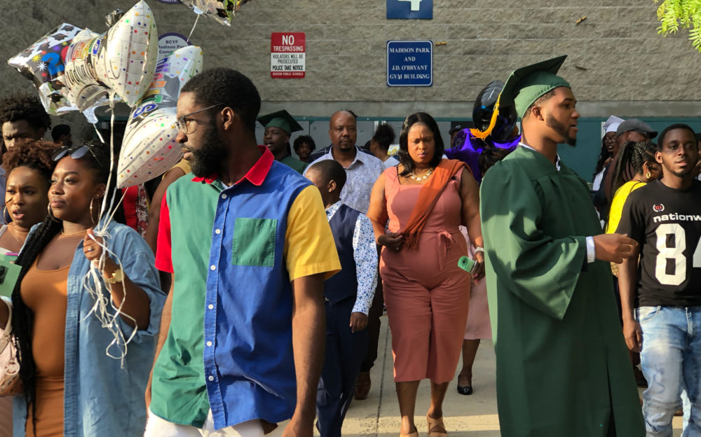 Families and graduates file out after WRA's graduation ceremony. (Max Larkin/WBUR)
