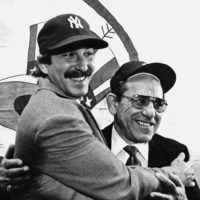 Dale Berra poses with his father at Yankee Stadium after Dale was traded to the Yankees from the Pittsburgh Pirates.  (Paul Burnett/AP)
