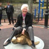 "Nancy Schön sits atop her sculpture ""Myrtle the Turtle"" last month. (Courtesy New England Aquarium)"