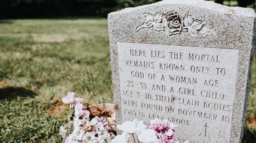 A headstone in an Allenstown cemetery honors two of the Bear Brook victims identified by New Hampshire investigators Thursday. (Allie Gutierrez for NHPR)