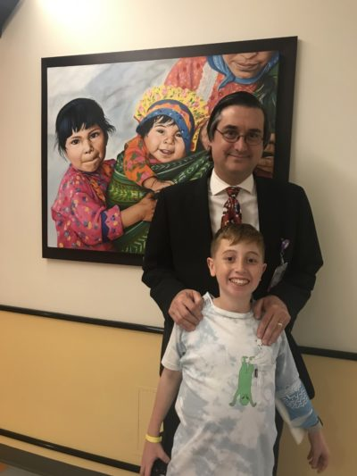Dr. David Weinstein and Jonah Pournazarian (front) (Courtesy Lora Pournazarian)