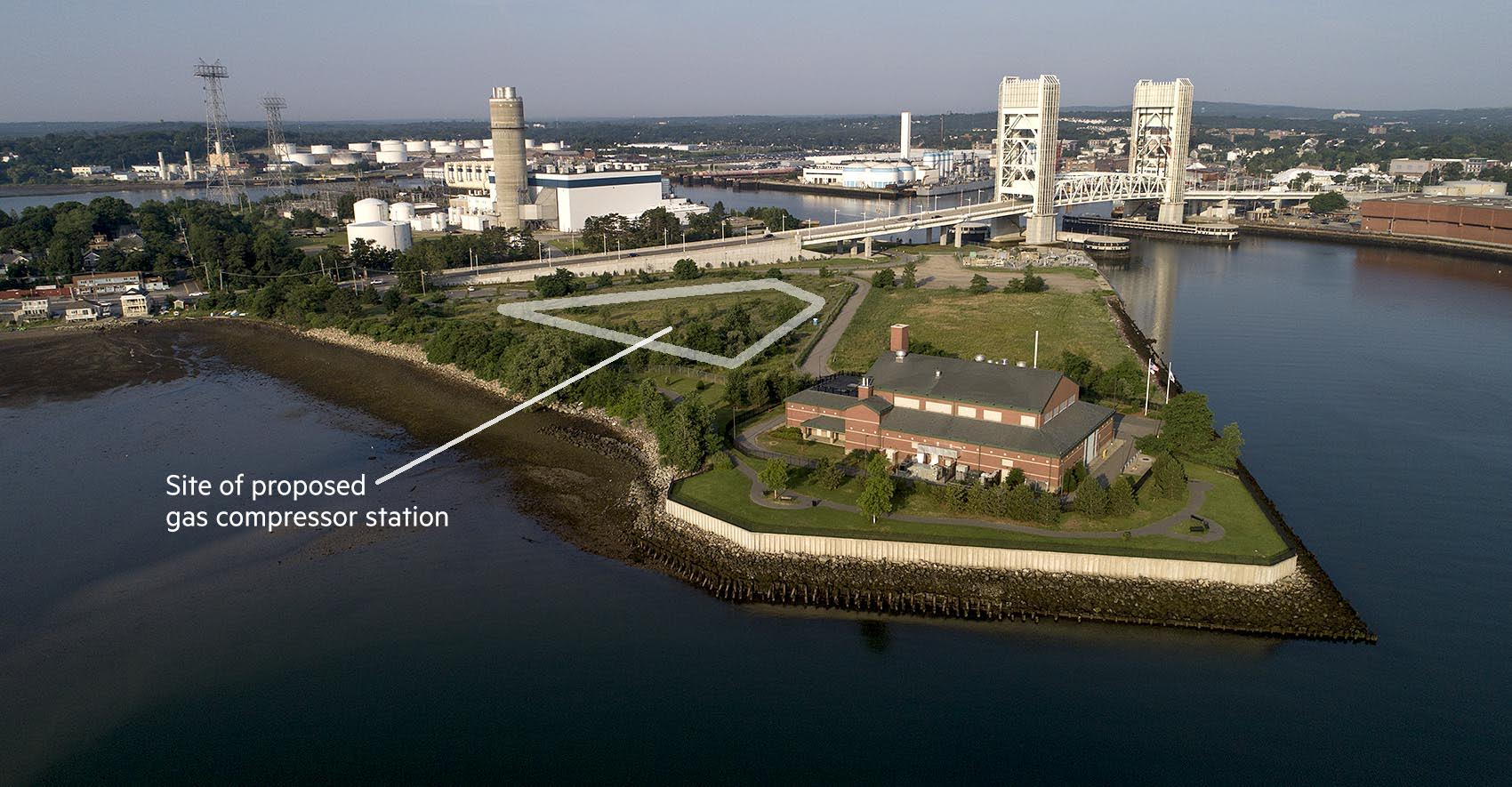 The proposed Weymouth compressor station would be constructed between the MWRA Braintree-Weymouth Pump Station, in the foreground, and Bridge Street, the road that crosses the Fore River Bridge. (Robin Lubbock/WBUR)