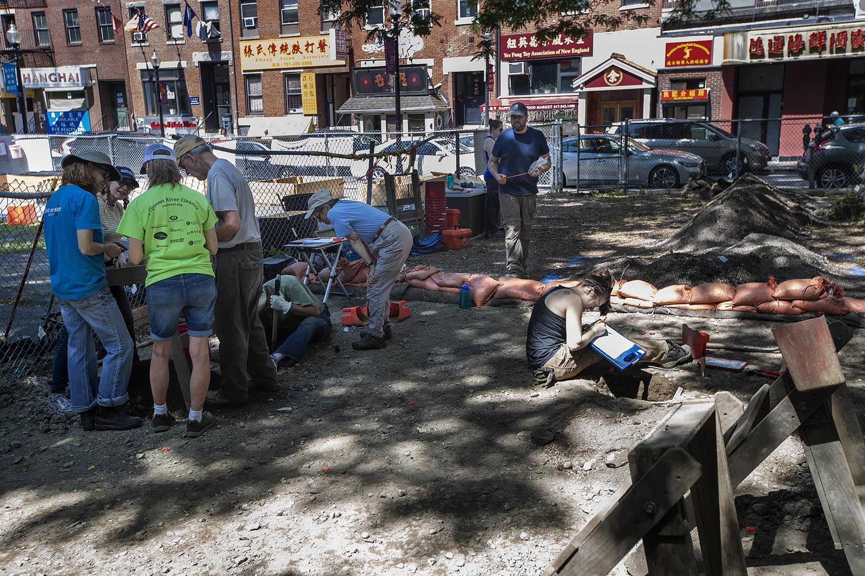 City of Boston Archaeologist Joseph Bagley walks into the first archaeological dig in Boston's historic Chinatown on Hudson Street. (Jesse Costa/WBUR)