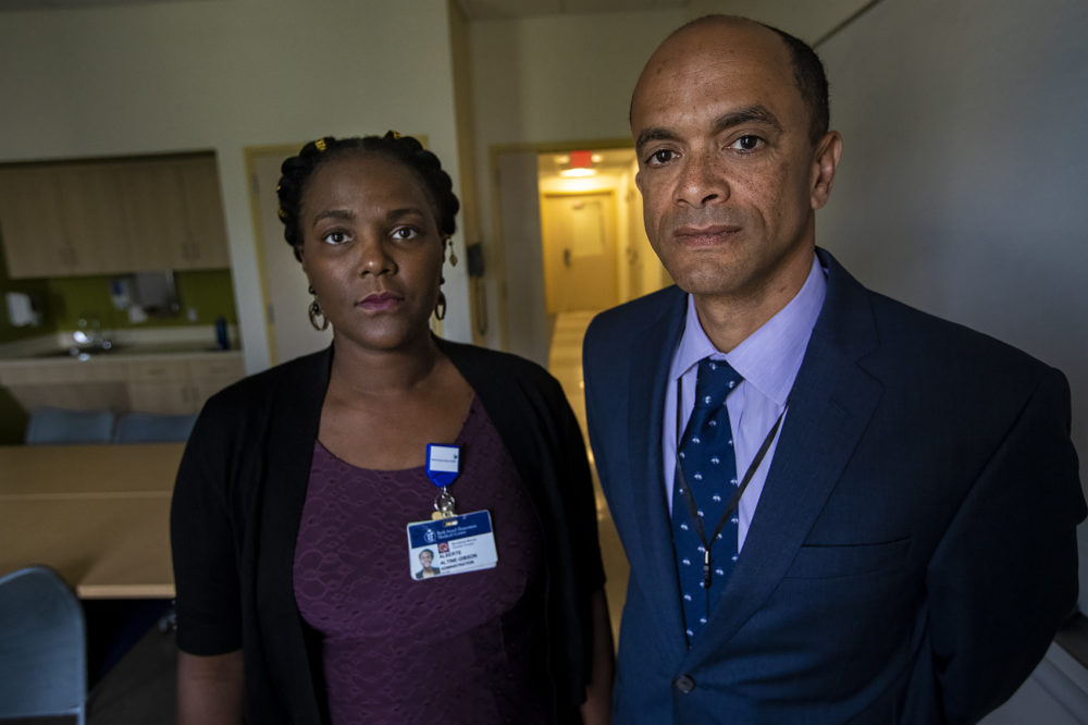 Alberte Altine-Gibson, left, and Dr. Kamau Karanja at the Bowdoin Street Health Center. (Jesse Costa/WBUR)