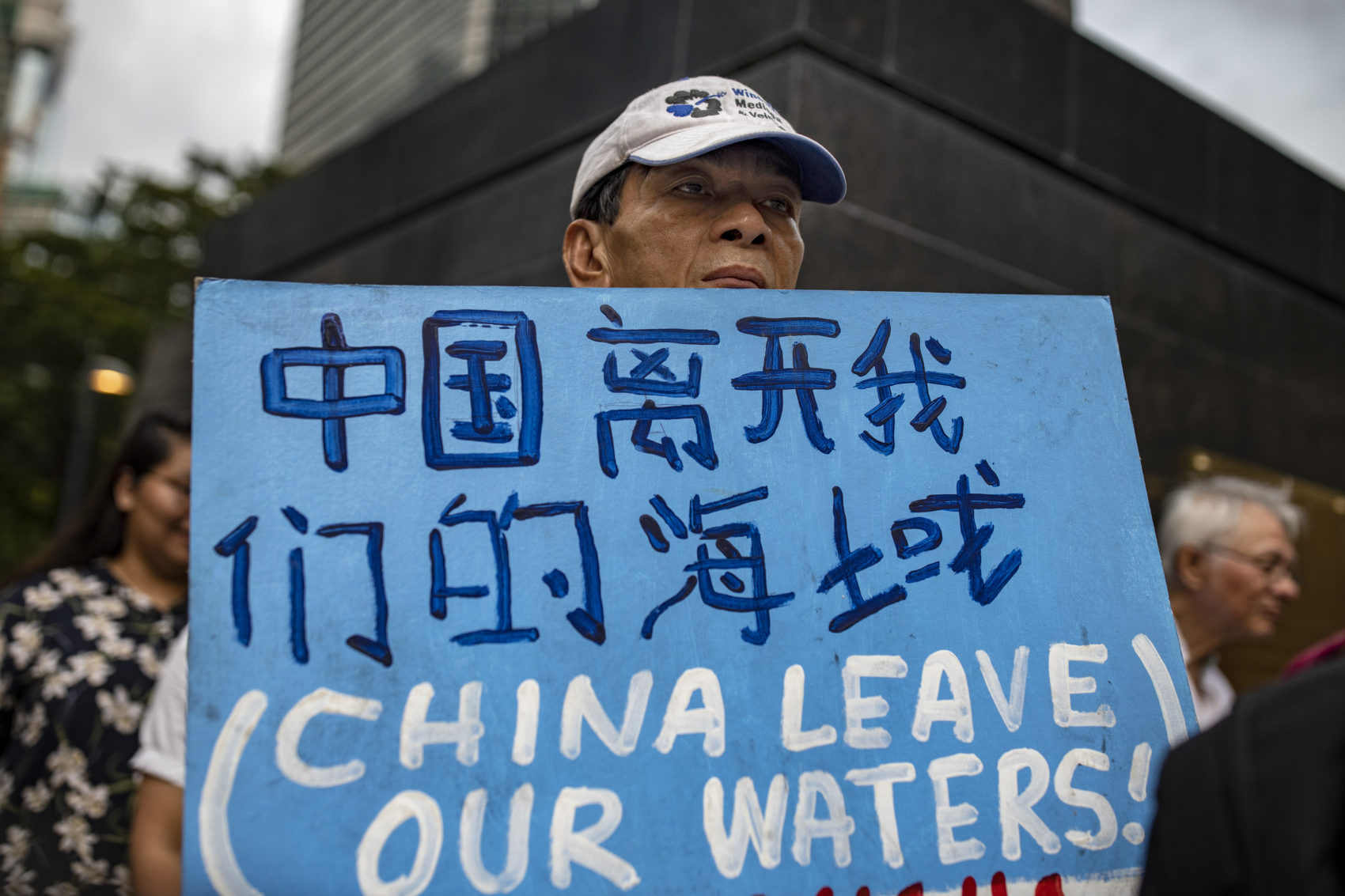 Filipinos take part in a protest condemning China's incursion at the West Philippine Sea in Makati, metro Manila, Philippines. (Ezra Acayan/Getty Images)