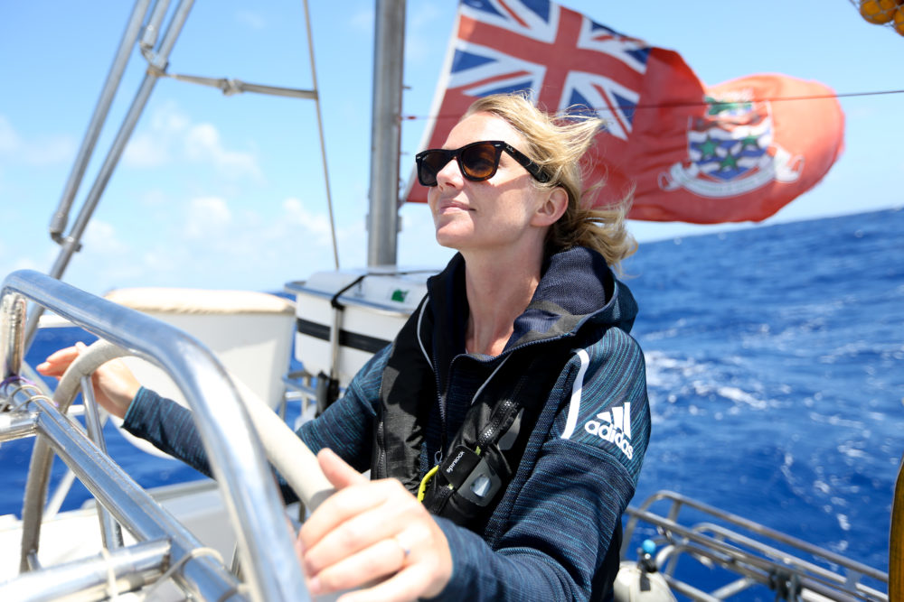 Emily Penn,eXXpedition mission director, at the helm during the North Pacific mission in 2018. (Courtesy ofEleanor Church Lark Rise Pictures)