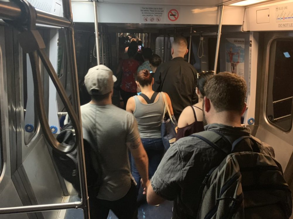 Commuters on an MBTA Blue Line train are evacuated near Government Center on Wednesday morning. (Carrie Jung/WBUR)