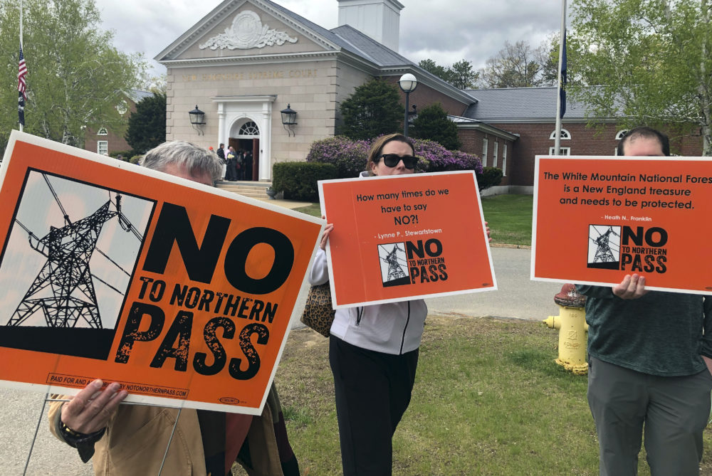 Opponents of the proposed Northern Pass power project protest outside the New Hampshire Supreme Court on May 15 in Concord, N.H. (Michael Casey/AP)