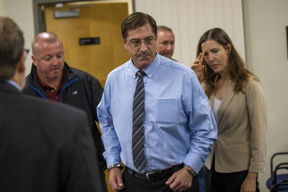 Greg Diatchenko enters the Massachusetts Parole Board room in Natick for his parole hearing Tuesday. (Jesse Costa/WBUR)