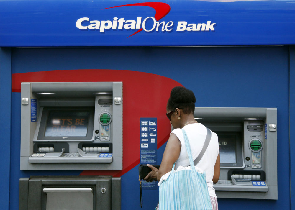 In this July 18, 2013, file photo, a woman uses a Capital One Bank automated teller machine in New York. (Mark Lennihan/AP)
