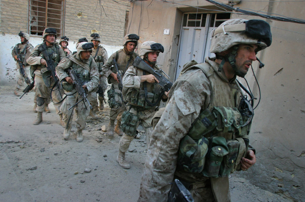 Seth Moulton, right, is seen with fellow Marines on the first day of the August 2004 Battle of Najaf. Moulton served four tours in Iraq. (Courtesy of Lucian Read)