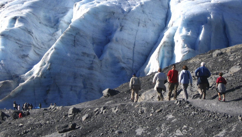 This August 2007 file photo shows hikers in Kenai Fjords National Park in Seward, Alaska on the path leading to the toe of Exit Glacier. (Beth Harpaz/AP)