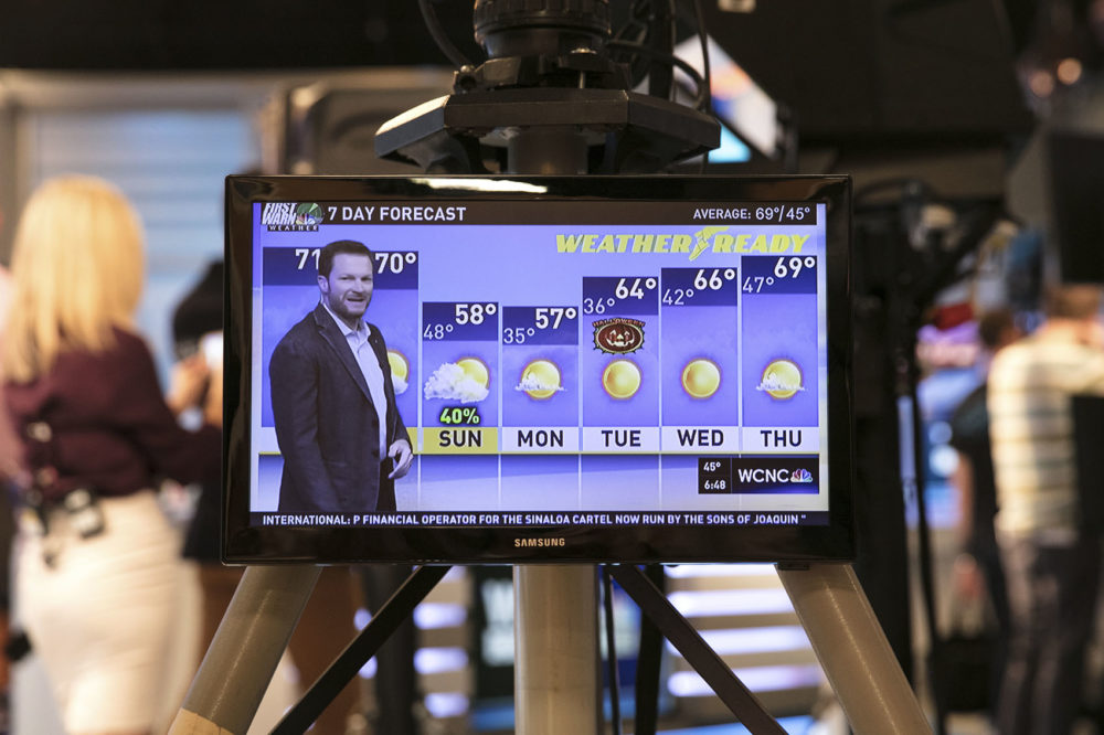 Dale Earnhardt Jr. delivers a surprise seven-day forecast at a Charlotte news station ahead of weekend NASCAR race in Martinsville to help launch Goodyear's new WeatherReady tire on Friday, Oct. 27, 2017, in Charlotte, N.C. (Jason Walle/AP Images for Goodyear)
