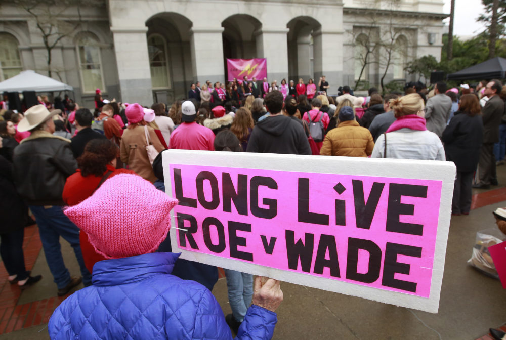 A sign is shown supporting Roe v. Wade at a rally, held by Planned Parenthood, commemorating the 45th anniversary of the landmark Supreme Court decision at the Capitol Monday, Jan. 22, 2018, in Sacramento, California. (AP Photo/Rich Pedroncelli)