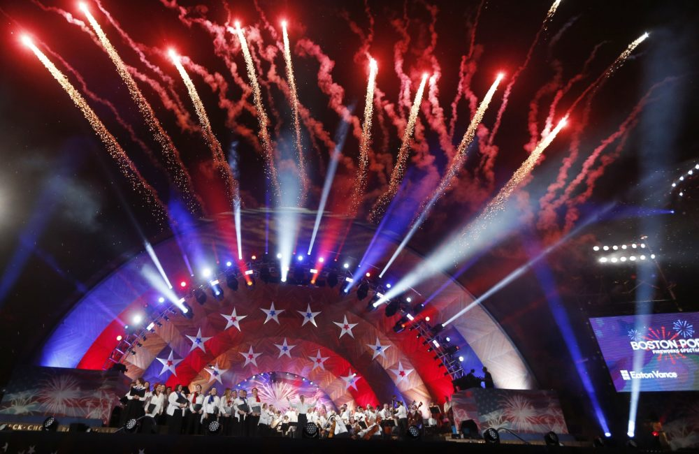 Fireworks explode over the Hatch Shell during rehearsal for the Boston Pops Fireworks Spectacular. (Michael Dwyer/AP)